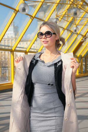 young blonde in sunglasses photo
