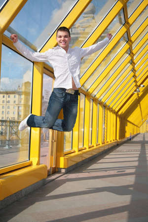 young man jumps on footbridge photo