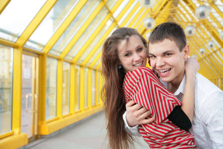 boy embraces girl on footbridge photo