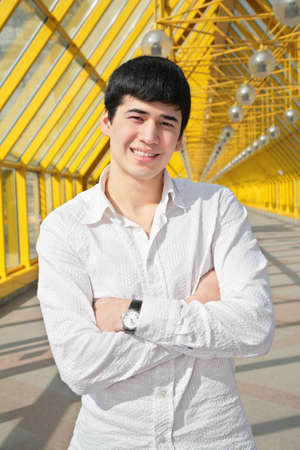diagonals: asian boy stand on footbridge Stock Photo