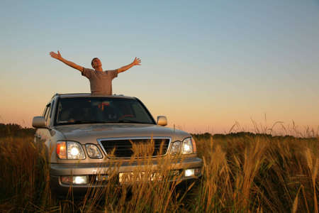 man with offroad car in field photo
