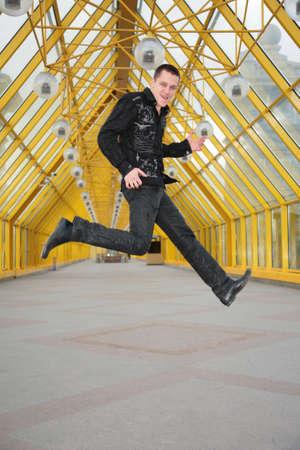 gitar: guy jump and  allegorize play on  guitar on footbridge