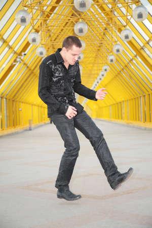 gitar: guy  allegorize play on  guitar on footbridge
