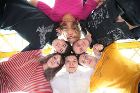 group of friends it stands after being embraced into circle it looks downward photo