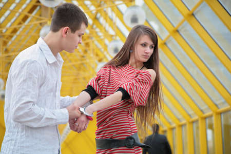 Young couple with handcuffs photo