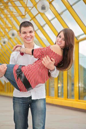 Boy hold girl photo