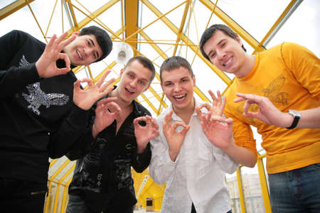 four friends with fingers ok photo