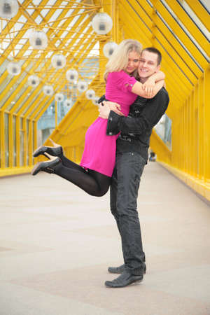 diagonals: boy hold girl on hand on footbridge Stock Photo