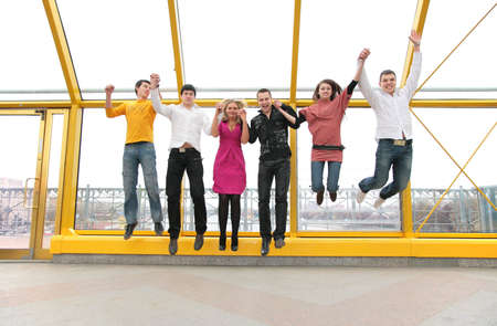 group of young people jump on footbridge photo