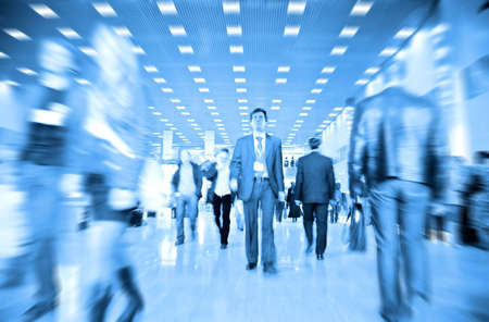 rush hour: business people motion blur Stock Photo
