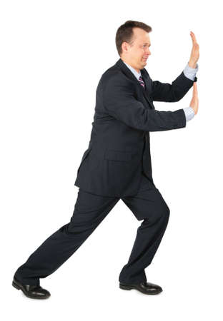 endeavor: businessman rests hands against wall, push somthing Stock Photo
