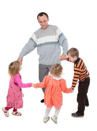 Man with three kids dancing photo