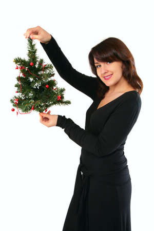 Young woman with christmas tree photo