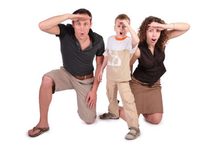 surprised kid: father, the son and mother have seen something and are surprised Stock Photo
