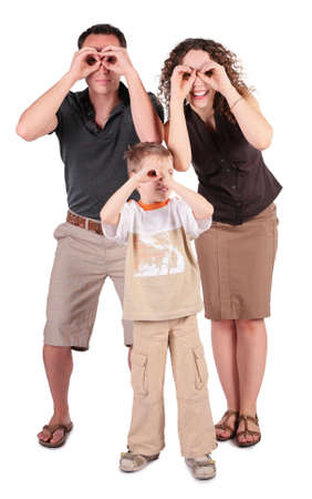 father,  son and mother look in field-glasses from hands photo
