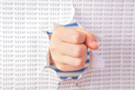 Fist punch through paper Stock Photo - 5105256