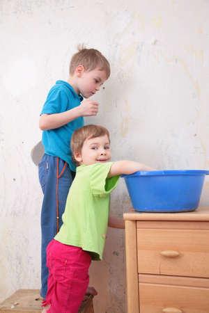 children and blue basin photo