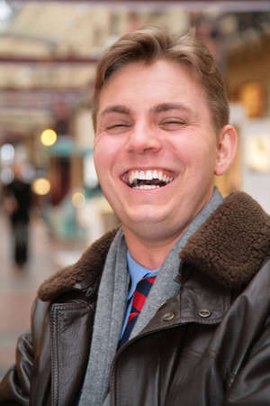 nice looking: laughing man in leather jacket Stock Photo