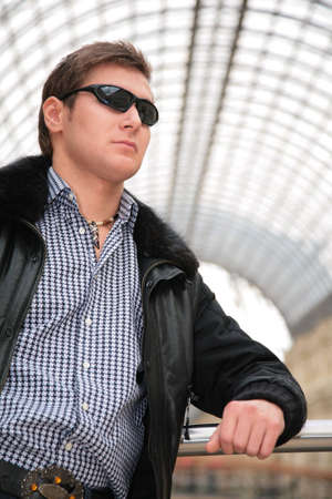 young man in black jacket and sunglasses photo