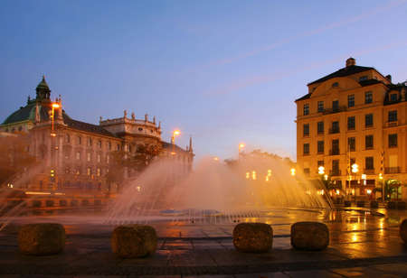 Fountain on square in evening. Munich