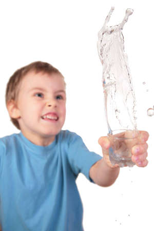 boy spills water from glass photo