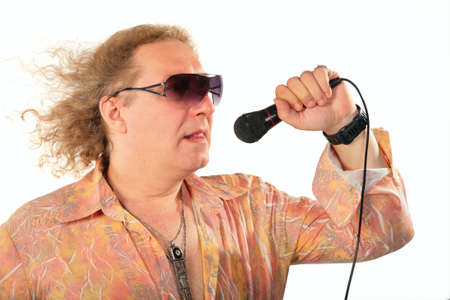 Mature man with microphone with windy hair Stock Photo - 5239448