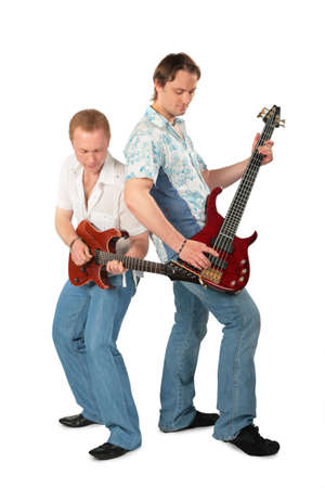 Two young men play on guitars photo