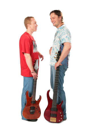 Two young men stand with guitars photo