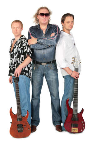Three men with two guitars. music group, full body. photo