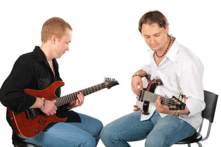 Two sitting men play on guitars photo