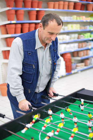 Man plays into  table football in store Stock Photo - 5218479