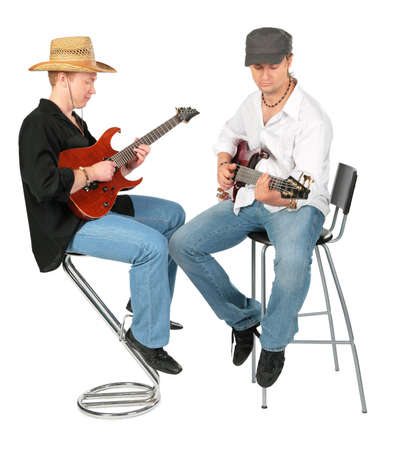 Two sitting men in hats  play on guitars photo
