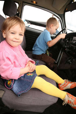 Little Girl and boy in car photo