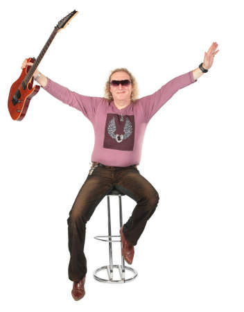 Happy man with guitar in raises hand photo
