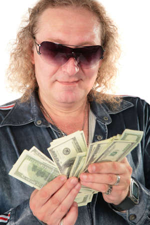Man in sunglasses with dollars photo