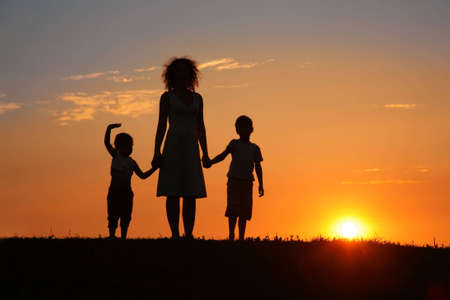 Mother and children on sunset silhouette Stock Photo - 5107670