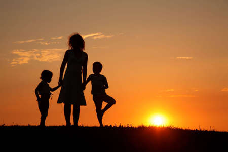 Mother and children on sunset silhouette Stock Photo - 5106116