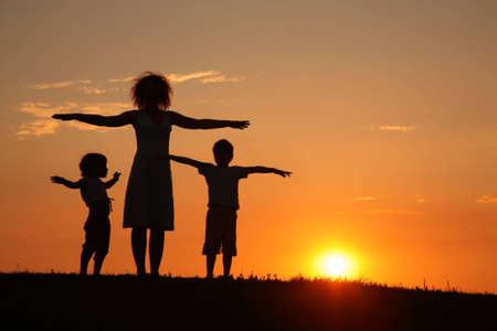 Mother and children on sunset sport training Stock Photo - 5107629