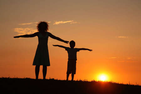Mother and son on sunset stretching Stock Photo - 5106108