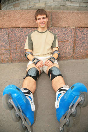 rollerblades: Sitting guy in rollerblades