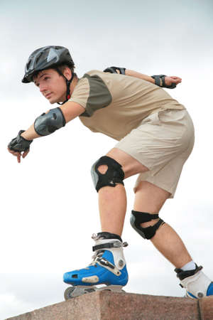 roller blade: Boy on rollerblades in starting position Stock Photo