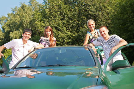 Group of friends with car outdoor Stock Photo - 5201551