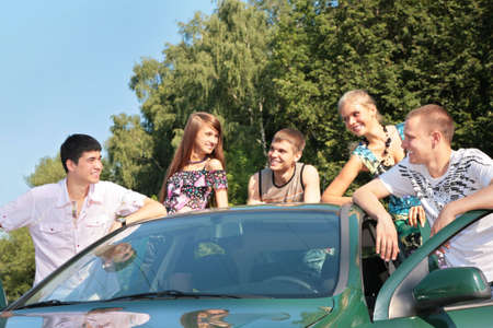 tripping: Group of friends with car outdoor Stock Photo