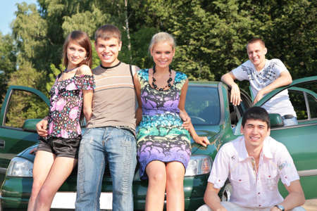 Group of friends with car outdoor Stock Photo - 5239407