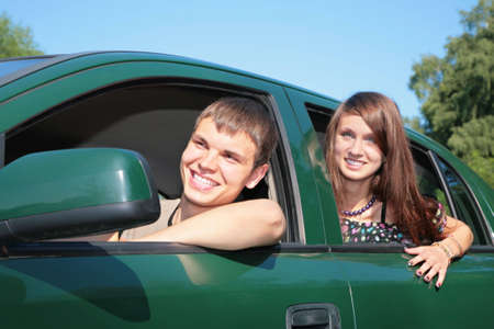 Young couple in car Stock Photo - 5239454