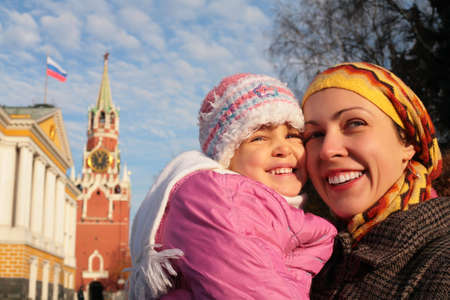 mother with little girl in Kremlin faces photo