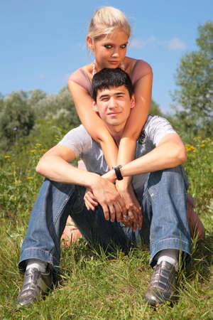 Couple sits on grass photo