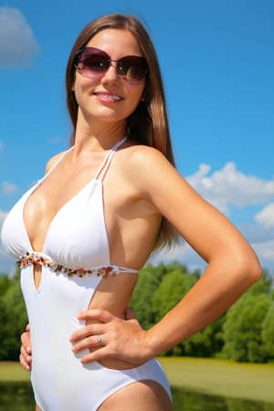 Girl in bathing suit and sunglasses photo