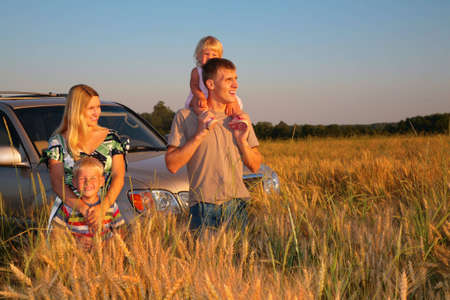 offroad: Family with offroad car on wheaten field
