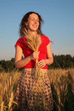earns: Young woman with earns on wheaten field